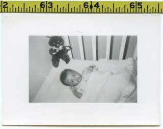 Vintage 1950s photo / Sweet Baby in Crib with Black Kitty Cat Toy in