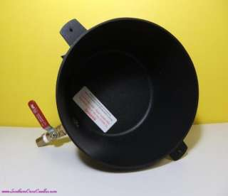 Into a solar wax melter where the wax will melt and filter through the