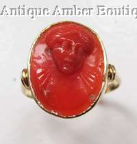 Antique carved red coral cameo ring in 18ct gold