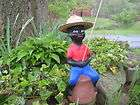 black fishing boy concrete statue pond lawn jockey