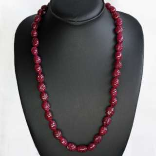 BEAUTIFUL OVAL SHAPED 395.00 CARAT NATURAL CARVED RED RUBY BEADS