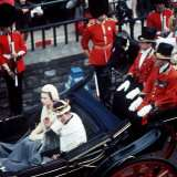 The Queen and Prince of Wales Drive Through Caernarvon After