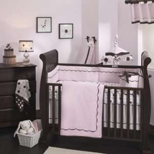 Cute pink and brown baby bedding in a baby girls nursery