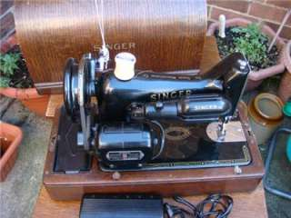 Vinage Old elecric and hand crank Singer Sewing Machine model 99K
