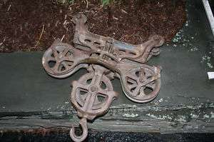 Antique cast iron barn hay carrier