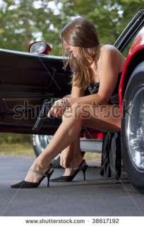 Spy Girl With Gun Exiting Sports Car Stock Photo 38617192
